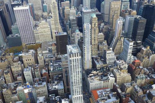 专家:大城市全面放宽落户 应避免楼市大起大落